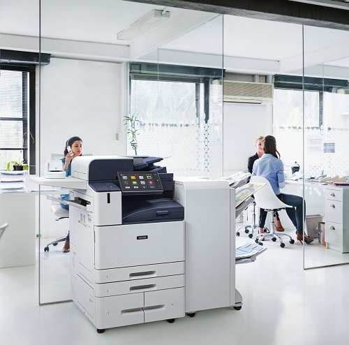 Businesswomen working in a bright modern but casual looking office space.